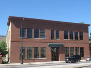 2324 University Ave. -  Midtown Commons. Historic renovated building, exposed brick & beams large windows at Raymond Station.